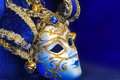 Carnival mask festive on the background of blue cloth Stock Photo