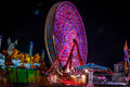 Carnival at night - rides in motion patterned lights Royalty Free Stock Photo