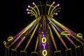Carnival ride yoyo swing illuminated at night Stock Photography