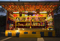 Carnival stand street kiosk with stuffed animals night with bright lights Royalty Free Stock Image