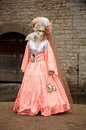 Carnival in venice a young woman a costume stands front of a wall Royalty Free Stock Photos