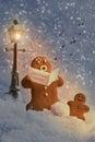 Carol singers gingerbread men at christmas Stock Images