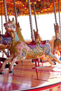 Carousel horses colourful and brightly patterned wooden on a Royalty Free Stock Photos