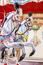 Carousel horses on a vintage carnival merry go round closeup of colorful roundabout with entertainment new Royalty Free Stock Photo