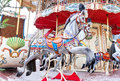 Carousel horses on a vintage retro carnival merry go round closeup of colorful roundabout with Royalty Free Stock Photo