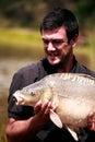 Carp fishing man hold big focus on eye Stock Images