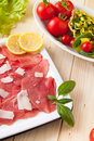Carpaccio and basket of Parmesan with veggies Royalty Free Stock Image