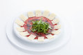Carpaccio,beef and carrot garnished with cheese slices Royalty Free Stock Photo