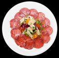 Carpaccio of beef, mushrooms, ruccola and cheese Royalty Free Stock Photography