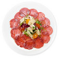 Carpaccio of beef, mushrooms, ruccola and cheese Stock Photo