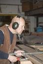 Carpenter adjusting clamp on workbench Royalty Free Stock Photo