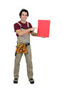 Carpenter with a blank board pointing to Royalty Free Stock Photos