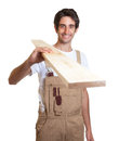 Carpenter carrying a wooden beam on an isolated white background for cut out Royalty Free Stock Photos