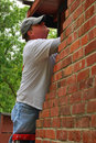 Carpenter Checking for Dry Rot Damage Royalty Free Stock Photo