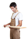 Carpenter checking wooden beam on an isolated white background for cut out Royalty Free Stock Images