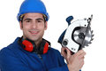 Carpenter with a circular saw. Royalty Free Stock Image