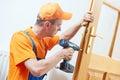Carpenter at door lock installation or repair