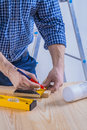 Carpenter drawing on wooden plank construction Royalty Free Stock Photo