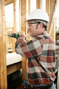 Carpenter Drilling Safely Royalty Free Stock Images