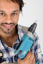 Carpenter with electric drill Royalty Free Stock Photos
