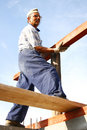 Carpenter fixing a long wood Royalty Free Stock Photo