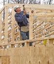 Carpenter framing gable end of house Royalty Free Stock Photo
