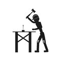 The carpenter hammers a nail Vector black icon on white background.