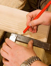 Carpenter hand with square Royalty Free Stock Image