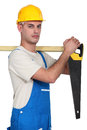 Carpenter with a handsaw. Stock Images