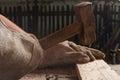 Carpenter knocking a nail into wood using hammer Royalty Free Stock Photo