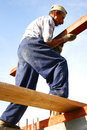 Carpenter making big effort Royalty Free Stock Photo