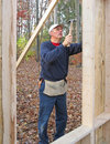 Carpenter nailing plywood sheathing Stock Images