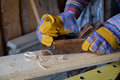 Carpenter planing board a s hands at work Stock Photography