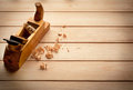 Carpenter's plane on wooden background Stock Photos