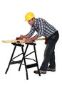 Carpenter sanding a plank of wood Royalty Free Stock Photo