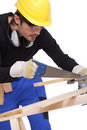 Carpenter sawing Royalty Free Stock Images