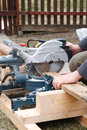 Carpenter sawing plank Stock Image
