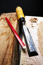 Carpenter tool on heavy wood Royalty Free Stock Photos