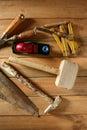 Carpenter tools saw hammer wood tape plane gouge Royalty Free Stock Photo