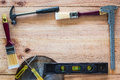 Carpenter tools on wood board Royalty Free Stock Photos