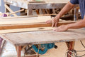 Carpenter use saw cut wood formake new furniture photo for make Stock Photo