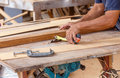 Carpenter use saw cut wood formake new furniture photo for make Stock Image
