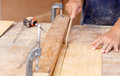 Carpenter use saw cut wood formake new furniture photo for make Stock Images