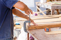 Carpenter use saw cut wood formake new furniture photo for make Royalty Free Stock Photography