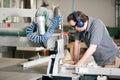 Carpenter using electric saw Royalty Free Stock Image
