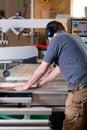 Carpenter using electric saw Stock Photos