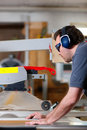 Carpenter using electric saw Royalty Free Stock Photo