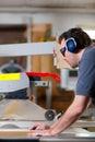 Carpenter using electric saw Royalty Free Stock Photo