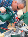 Carpenter using  an electric saw Royalty Free Stock Photos