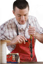 Carpenter using hand-crank drill on wood Royalty Free Stock Photo